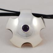 Scalloped silver pendant with amethyst