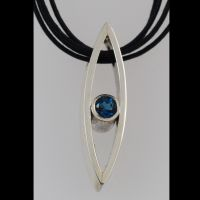 Silver pendant set with topaz